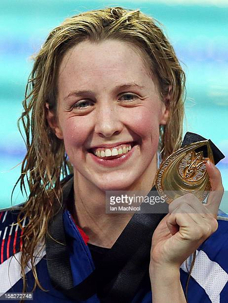 Hannah Miley of Great Britain poses with her gold medal from her victory in the Women's 400m IM final during day one the FINA World Short Course...