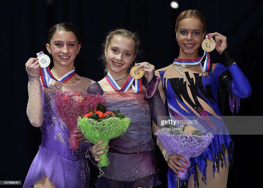 Hannah Miller of USA with her silver medal, Elena Radionova of Russia with her gold and Anna Pogorilaya of Russia with her bronze medal in the Junior Ladies Free Skating during the Grand Prix of Figure Skating Final 2012 at the Iceberg Skating Palace on December 8, 2012 in Sochi, Russia.