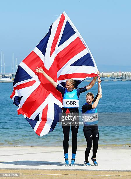 Hannah Mills and Saskia Clark of Great Britain celebrate after finishing second and taking the silver medal in the 470 Women's Class Sailing on Day...