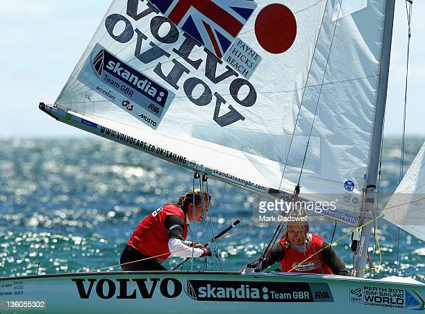 Hannah Mills and Saskia Clark of Great Britain compete in the 470 Women's Two Person Dinghy medal race on the Centre Course during day 16 of the ISAF...