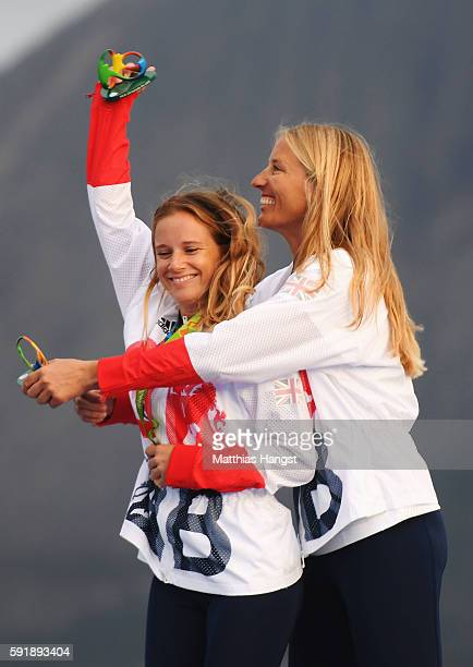 Hannah Mills of Great Britain and Saskia Clark of Great Britain celebrate winning gold in the Women's 470 class at the Marina da Gloria on Day 13 of...