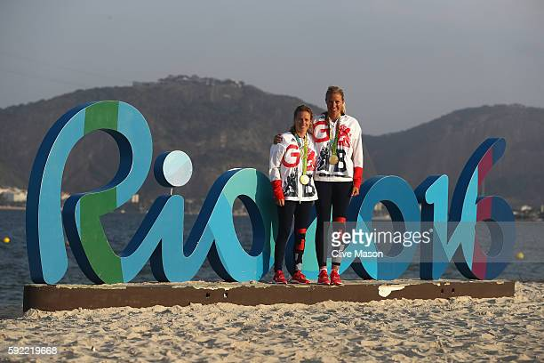 Hannah Mills of Great Britain and Saskia Clark of Great Britain pose with their gold medals after winning the womens 470 class medal race at the...