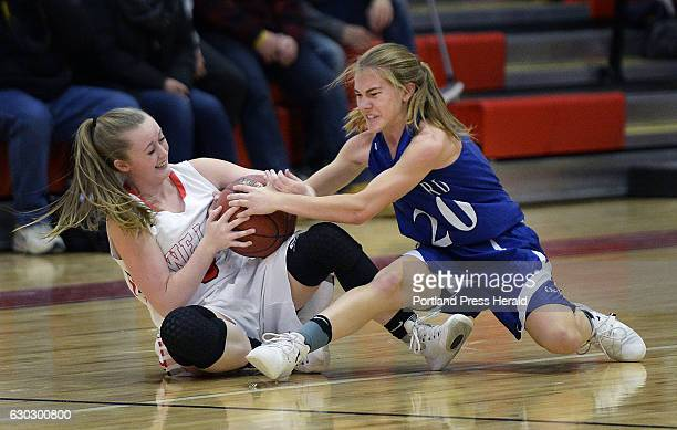 Hannah Moody of Wells battles for a loose ball with Kaitlyn Cote of Old Orchard Beach Friday December 16 2016