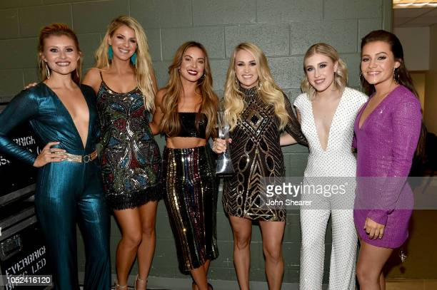 Hannah Mulholland Jennifer Wayne Naomi Cooke Carrie Underwood Madison Marlow and Taylor Dye take photos during the 2018 CMT Artists of The Year at...