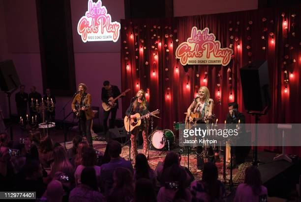 Hannah Mulholland Naomi Cooke and Jennifer Wayne of Runaway June perform at the Radio Disney Country Let The Girls Play Pop Up Show at The Bell Tower...