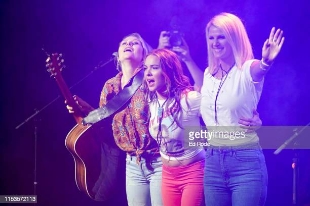 Hannah Mulholland Naomi Cooke and Jennifer Wayne of Runaway June perform at The Cowan at Topgolf on June 03 2019 in Nashville Tennessee