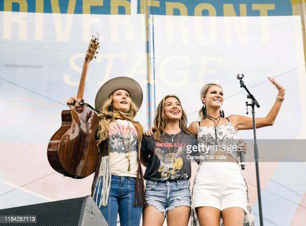 Hannah Mulholland Naomi Cooke and Jennifer Wayne of Runaway June perform on stage during day 1 of 2019 CMA Music Festival on June 06 2019 in...