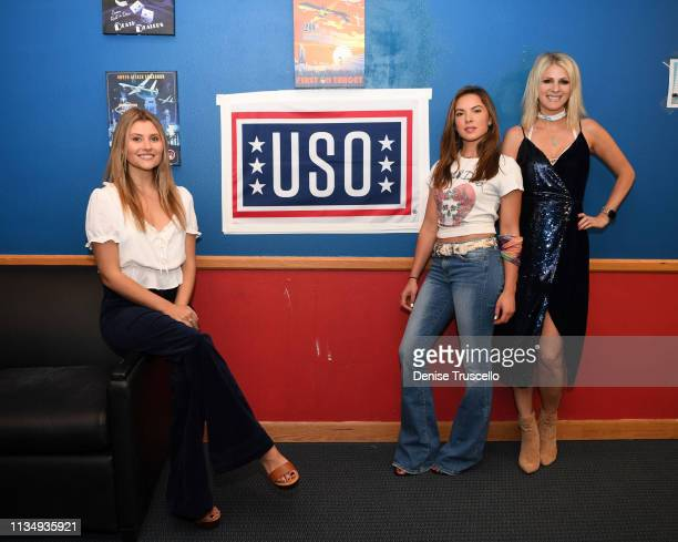 Hannah Mulholland Naomi Cooke and Jennifer Wayne of Runaway June pose for a photo backstage at ACM PFAC USO performance at Nellis Airforce Base on...