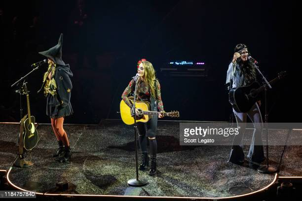 Hannah Mulholland Naomi Cooke and Jennifer Wayne of Runaway June perform dressed up for Halloween during the Cry Pretty Tour 360 at Little Caesars...