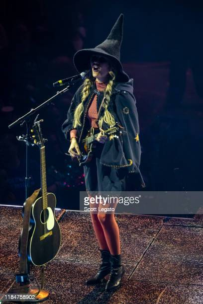 Hannah Mulholland of Runaway June perform dressed up for Halloween during the Cry Pretty Tour 360 at Little Caesars Arena on October 31 2019 in...