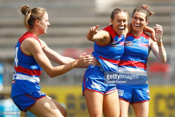 Hannah Munyard of the Bulldogs celebrates a goal during the round six AFLW match between the Western Bulldogs and the Fremantle Dockers at Whitten...