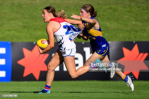 Hannah Munyard of the Bulldogs is tackled by Mikayla Bowen of the Eagles during the 2020 AFLW Round 04 match between the West Coast Eagles and the...