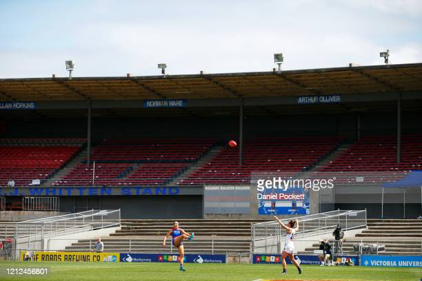 Hannah Munyard of the Bulldogs kicks a goal in front of empty stands during the round six AFLW match between the Western Bulldogs and the Fremantle...
