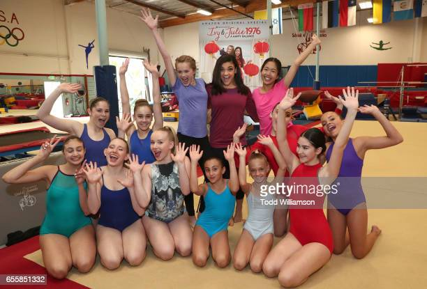 """Hannah Nordberg, Laurie Hernandez and Nina Lu pose with gymnasts at an Amazon Original Special """"An American Girl Story - Ivy & Julie 1976: A Happy..."""