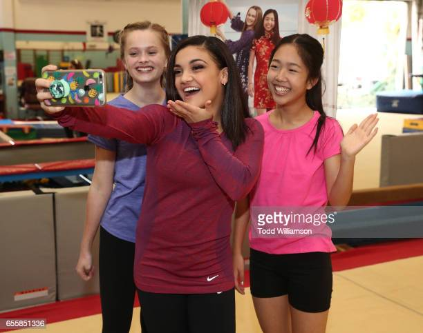 """Hannah Nordberg, Laurie Hernandez and Nina Lu take a selfie at an Amazon Original Special """"An American Girl Story - Ivy & Julie 1976: A Happy..."""