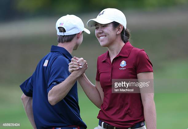 Hannah O'Sullivan of USA reacts to a long put by Austin Connelly during the first round of the 2014 Junior Ryder Cup at Blairgowrie Golf Club on...