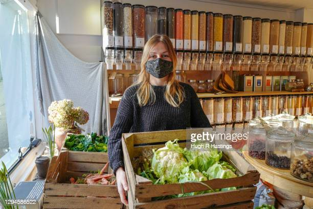 Hannah Pearce, founder of un_wrap, the zero-waste provisions store which remains open goes about her day on January 5, 2021 in Falmouth, United...