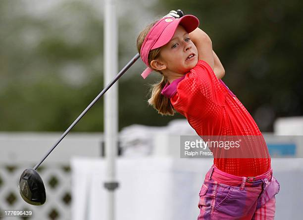 Hannah Ports watches her drive as she competes in the Girl's 79 Division during a regional round of the Drive Chip Putt Championships on August 25...