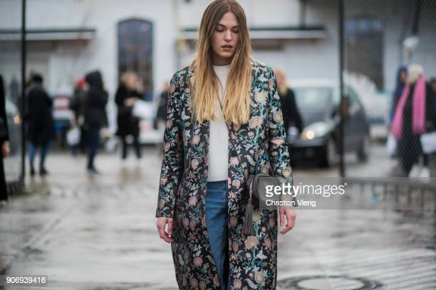 Hannah Pot d'Or wearing coat with floral print cropped denim jeans white boots is seen outside Marina Hoermanseder during the Berlin Fashion Week...