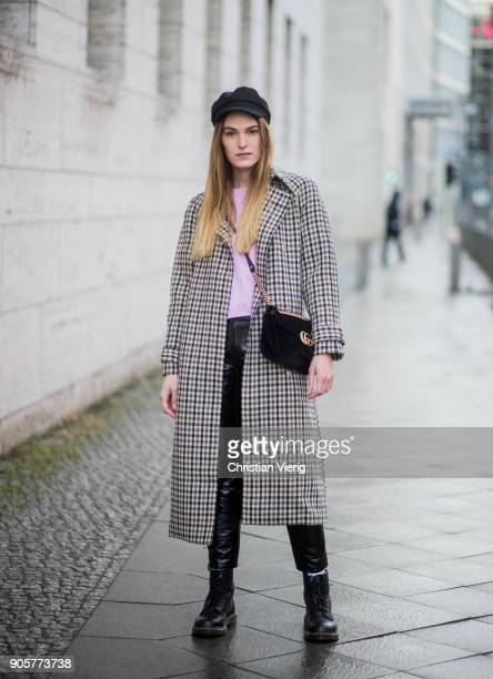Hannah Pot d'Or wearing pink Acne shirt grey checked wool coat Asos flat cap Gucci bag black vinyl pants Weekday Dr Martens boots is seen during the...