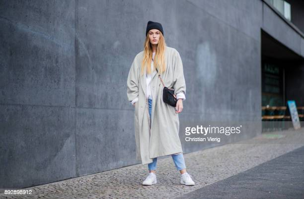 Hannah Pot d'Or wearing white Reebok sneakers Levis denim jeans Urban Outfitters sweater vintage coat black wool hat Gucci bag on December 14 2017 in...
