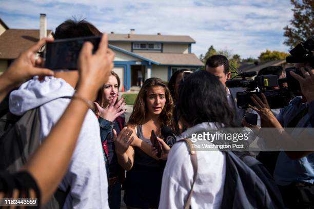 Hannah SchoopingGutierrez center a sophomore at Saugus High School talks to reporters about the school shooting at Saugus High School earlier that...