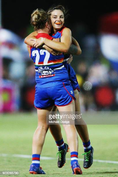 Hannah Scott of the Bulldogs and Nicole Callinan celebrate the win on the final siren during the round four AFLW match between the Western Bulldogs...