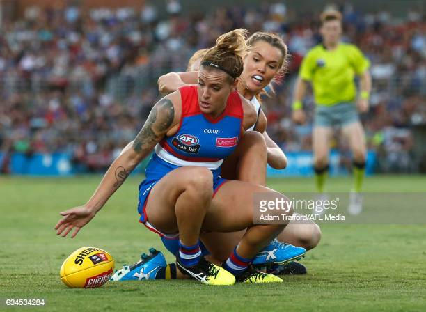 Hannah Scott of the Bulldogs is tackled by Abbey Holmes of the Crows during the 2017 AFLW Round 02 match between the Western Bulldogs and the...