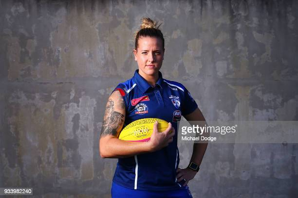 Hannah Scott showing off her Warrior Woman tattoo for the strong women in her life poses during a Western Bulldogs AFLW media opportunity at Victoria...