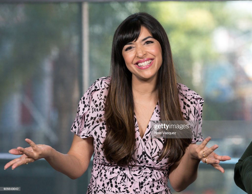 Hannah Simone visits 'Extra' at Universal Studios Hollywood on February 28, 2018 in Universal City, California.