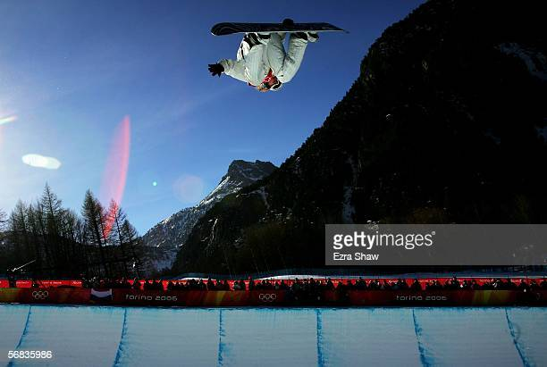 Hannah Teter of the United States competes in the Womens Snowboard Half Pipe Final on Day 3 of the 2006 Turin Winter Olympic Games on February 13...