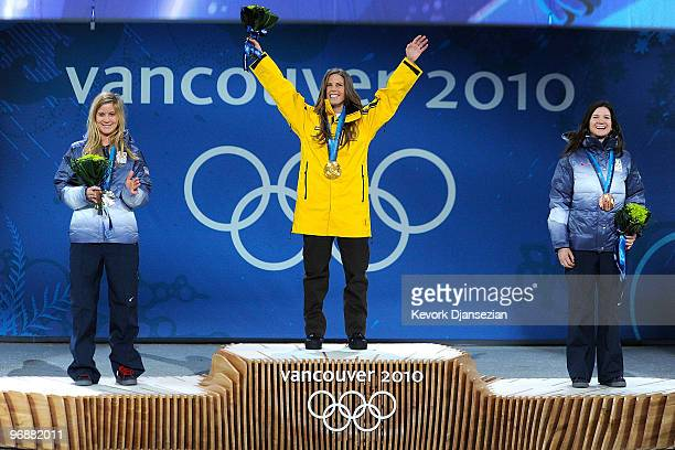 Hannah Teter of United States celebrates winning Silver Torah Bright of Australia Gold and Kelly Clark of United States Bronze during the medal...