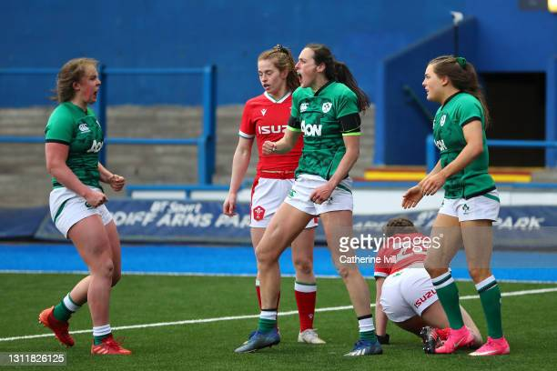 Hannah Tyrrell celebrates after scoring their seventh try during the Women's Six Nations match between Wales and Ireland at Cardiff Arms Park on...