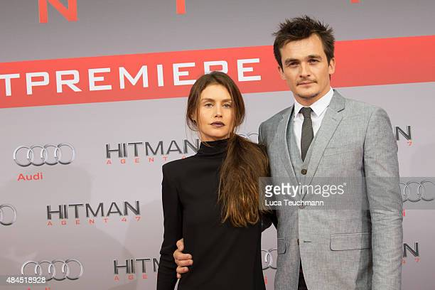 Hannah Ware and Rupert Friend attend the 'Hitman - Agent 47' world premiere at CineStar on August 19, 2015 in Berlin, Germany.