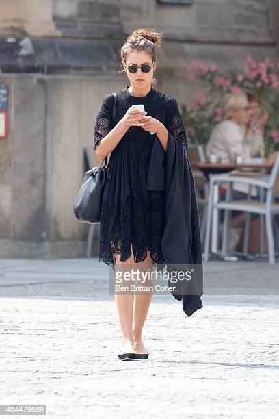 Hannah Ware is seen checking her smartphone in Berlin on August 19, 2015 in Berlin, Germany.