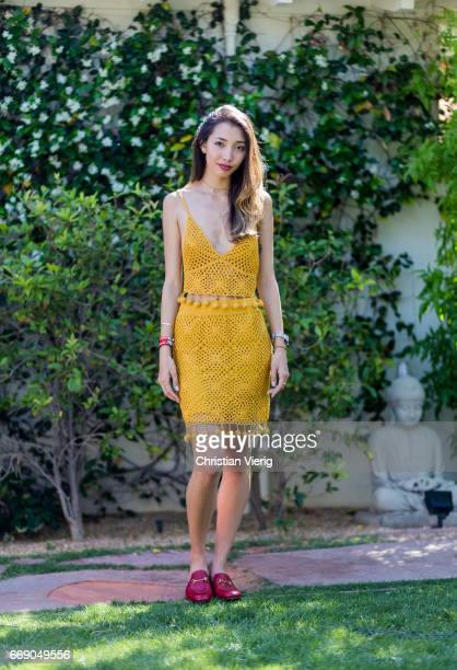 Hannah wearing a mustard dress Gucci slippers attends day 2 of the 2017 Coachella Valley Music Arts Festival Weekend 1 on April 15 2017 in Indio...