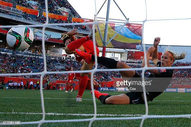 Hannah Wilkinson of New Zealand scores against Ren Guixin of China PR during the FIFA Women's World Cup Canada 2015 Group A match between China PR...
