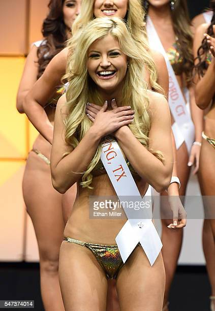 Hannah Williams of Irving Texas reacts after being named one of the top 10 finalists during the 20th annual Hooters International Swimsuit Pageant at...