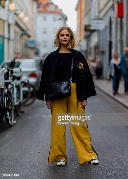 Hannah Witt wearing yellow wide tracksuit pants Converse chucks black jacket tshirt and bag outside Revolver Fair during the third day of the...