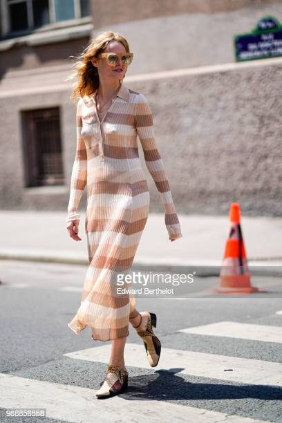 Hanne Gaby Odiele wears a brown striped dress sunglasses shoes outside Acne Studios during Paris Fashion Week Womenswear Fall Winter 2019 on July 1...