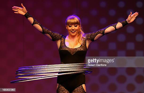 Hanne Grant performs with Hula Hoops during a National Institute of Circus Arts photo call for 'Leap of Faith Circus in Motion' at NICA on April 3...