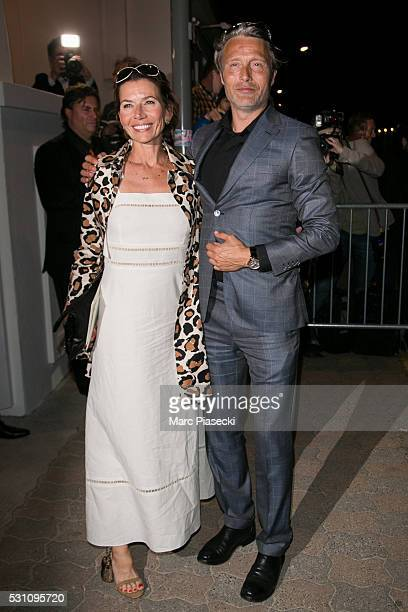 Hanne Jacobsen and Mads Mikkelsen arrive to attend the 'Vanity Fair and Chanel' party during the annual 69th Cannes Film Festival at 'Tetou'...