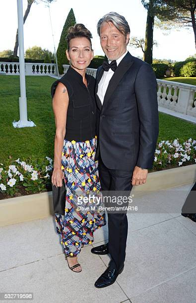 Hanne Jacobsen and Mads Mikkelsen attend amfAR's 23rd Cinema Against AIDS Gala at Hotel du CapEdenRoc on May 19 2016 in Cap d'Antibes France