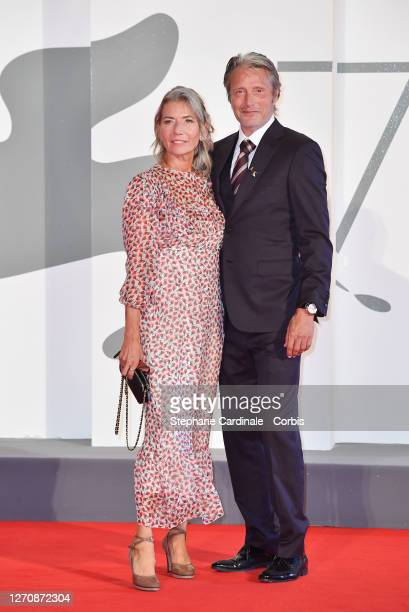 Hanne Jacobsen and Mads Mikkelsen walk the red carpet of the Kineo Prize at the 77th Venice Film Festival on September 05 2020 in Venice Italy