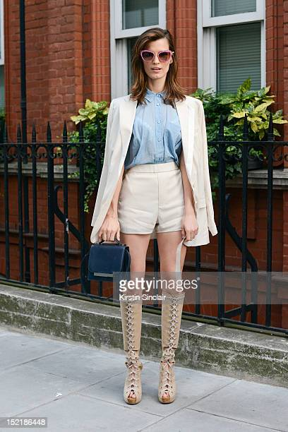 Hanneli Mustaparta model and fashion blogger, wearing an Acne jacket, shirt and shorts, The Row bag, Acne boots, Miu Miu sunglasses on day 3 of...
