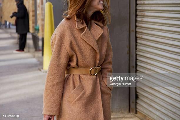 Hanneli Mustaparta seen at Skylight Clarkson Sq outside the Ralph Lauren show wearing tan coat with waist belt during New York Fashion Week Women's...