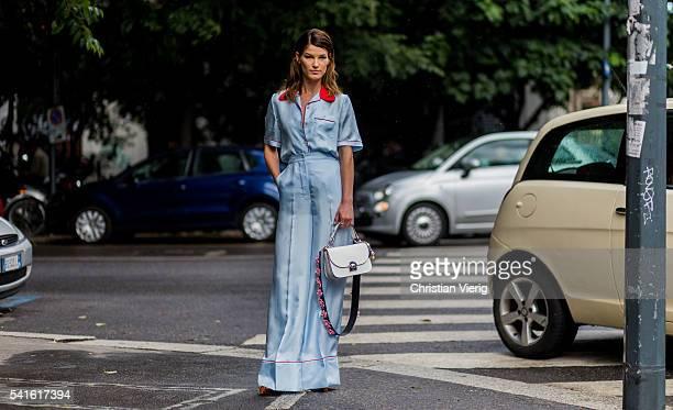 Hanneli Mustaparta wearing a babyblue Prada pyjama and white bag outside Prada during the Milan Men's Fashion Week Spring/Summer 2017 on June 19 2016...