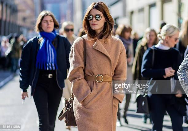 Hanneli Mustaparta wearing a bronze wool coat with belt from Ralp Lauren seen outside Ralph Lauren during New York Fashion Week Women's Fall/Winter...
