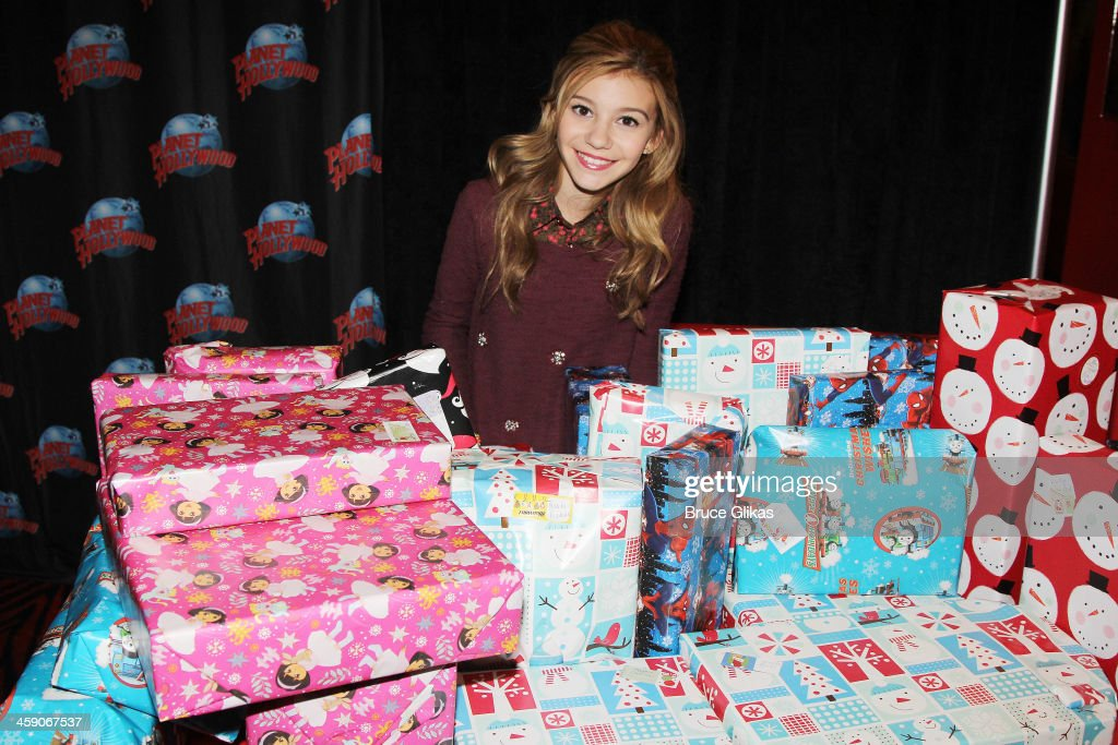 G. Hannelius of Disney's 'Dog with a Blog' hosts a special holiday party for underprivileged children from WHEDco (a local outreach program in the South Bronx) at Planet Hollywood Times Square on December 22, 2013 in New York City.