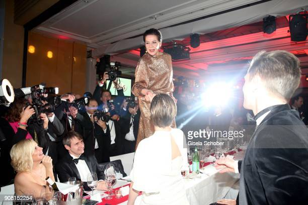Hannelore Elsner steps on the table during the German Film Ball 2018 party at Hotel Bayerischer Hof on January 20 2018 in Munich Germany
